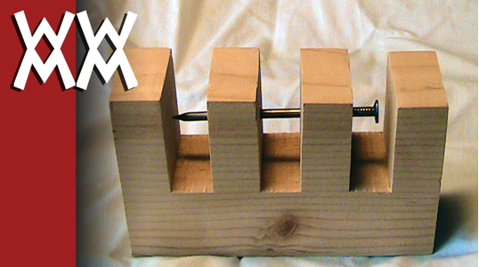 Impossible_nail-through-wood_trick