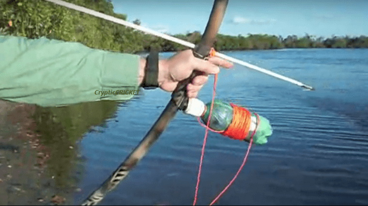 How to make a bowfishing reel from a soda bottle for Bow fishing reel