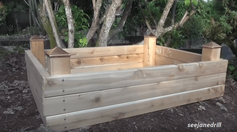 Building a raised garden bed in under an hour on a - What to put under raised garden beds ...